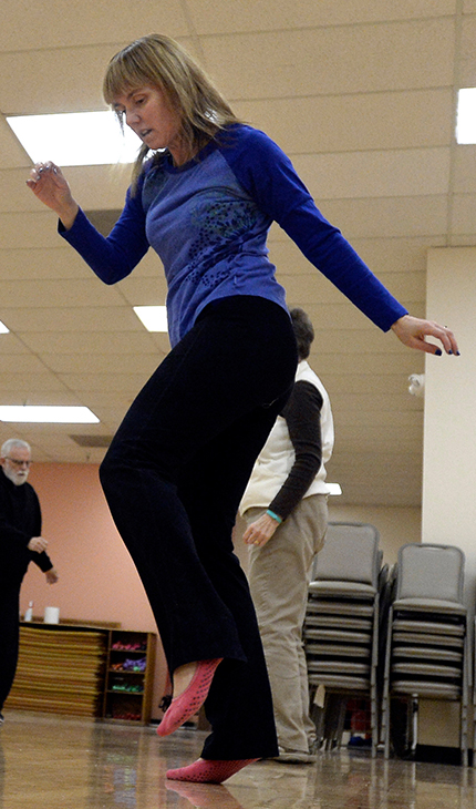 "Tina Schoenherr, of Hudson, dances to the music during a ""reconnect with your body"" workout on Wednesday, Jan. 21, at the Apex Community Center in Arvada."
