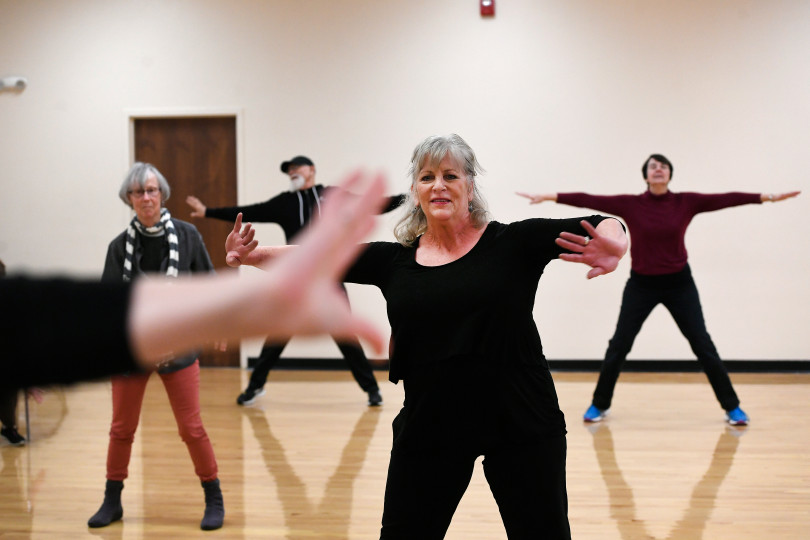 ARVADA, CO - JANUARY:  Karen Talcot, second from right, takes part in a Reconnect with your Body dance class at APEX Community Recreation Center on January 24, 2018 in Arvada, Colorado. Talcot, who has had Parkinson's for seven years takes several exercise classes a week including the Reconnect With Your Body class which is every Tuesday afternoon. This is a dance class that emphasizes a lot of rhythmic movement. The University of Colorado produced new research that says hard, physical exercise can stall the onset of Parkinson's Disease. Treadmills, fast walking, no-contact boxing and dancing are just some of the exercises people can use to stave off Parkinson's disease.  The class is taught by Sarah Leversee. (Photo by Helen H. Richardson/The Denver Post)